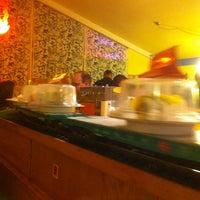 Photo taken at Sushi Train by Angela M. on 12/1/2012
