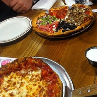 Photo taken at Hideaway Pizza by Angela M. on 1/1/2015