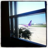 Photo taken at Gate 79 by Levon E. on 12/13/2013