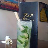 Photo taken at Zafra Cuban Restaurant & Rum Bar by Monica🚒 . on 5/6/2014