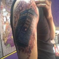 Photo taken at Tuff City Tattoos by Demetrio L. on 11/8/2013