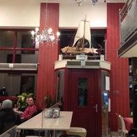 Photo taken at Άελλα by Thalia S. on 3/16/2012
