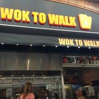Photo taken at Wok to Walk by Luiza C. on 8/7/2013