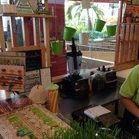 Photo taken at Mooshi Green Smoothie + Juice Bar by Kristina M. on 2/16/2014