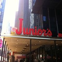 Photo taken at Junior's Restaurant & Bakery by K D. on 4/21/2013
