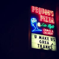 Photo taken at Pequod's Pizzeria by Max T. on 11/19/2012