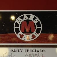 Photo taken at Mars Cafe by Crystal on 11/18/2012