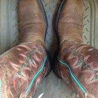 Photo taken at Hawkeye Tack & Western Wear by Anna H. on 4/26/2014