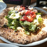 Photo taken at Tutta Bella Neapolitan Pizzeria by Vivek on 6/29/2013