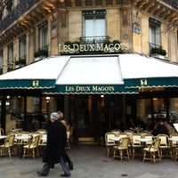 Photo taken at Les Deux Magots by Darren W. on 3/1/2013