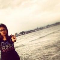 Photo taken at Wisata Pantai Boom Tuban by Ara O. on 2/1/2014