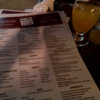 Photo taken at Salute wine bar & more by EatingRochester on 6/14/2014