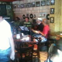 Photo taken at Pizzaria Mão na Roda by Guto B. on 12/29/2012