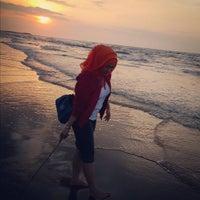 Photo taken at Pantai Pasir Kencana by Andi Dian M. on 7/19/2015