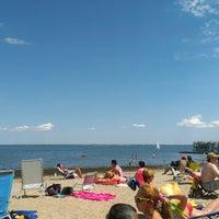 Photo taken at Calf Pasture Beach by Melinda Z. on 6/22/2014