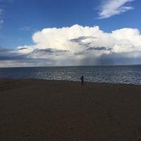 Photo taken at Gimli Public Beach by Sheryl R. on 5/3/2015