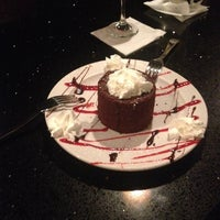 Photo taken at O'Bistro Cafe by Bruna B. on 4/27/2014