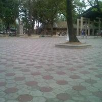 Photo taken at Talisay city public plaza by Janre O. on 3/11/2014
