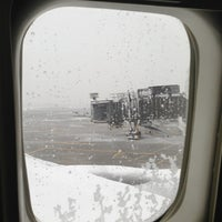 Photo taken at Gate C128 by Dominic P. on 3/8/2013