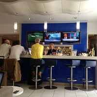 Photo taken at Delta Sky Club by J.A. D. on 4/11/2013