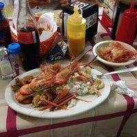 Photo taken at Mariscos Juan Chinchoncha by Ivan R. on 6/18/2014