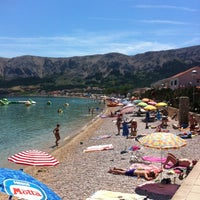 Photo taken at Baška Beach by Dmitry A. on 6/14/2013