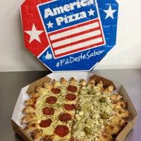 Foto tirada no(a) America Pizza por Murilo M. em 2/7/2014