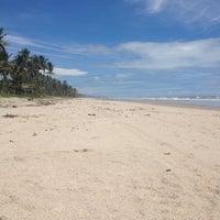 Photo taken at Praia da Costa by Polhyana S. on 1/23/2014