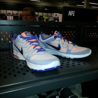 Photo taken at Nike Factory Store by Marie on 8/17/2013