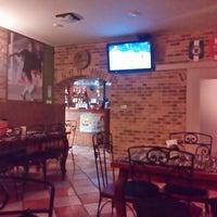 Photo taken at Pizzeria Victoria by Jozef U. on 2/19/2014