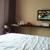 Photo taken at Grand Whiz Hotel by Fahar on 9/1/2014