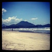 Photo taken at Praia Grande by Daniela A. on 2/25/2013