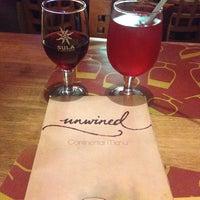 Photo taken at Unwind Cafe by Jomi A. on 7/18/2014