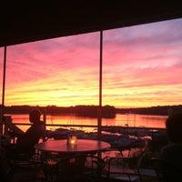 Photo taken at Rick's Cafe Boatyard by Anitra L. on 9/16/2012