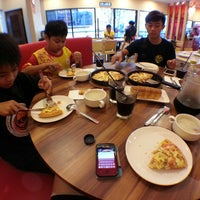 Photo taken at Pizza Hut by Aaron C. on 3/12/2014