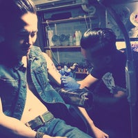 Photo taken at Tattoo Bar by Jia K. on 3/22/2014