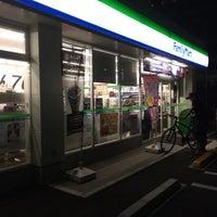 Photo taken at ファミリーマート東本浦店 by Kaoru S. on 9/22/2014