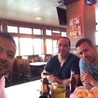 Photo taken at El Pulpo Restaurant by Hector C. on 6/1/2014