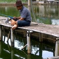 Photo taken at Kolam Pemancingan Pulo Gebang by Chandra A. on 1/5/2013