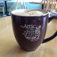 Photo taken at The Attic Books & Coffee by Brian J. on 10/1/2012