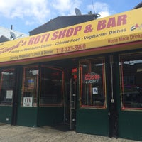 Photo taken at Singh's Roti Shop by Selina H. on 5/4/2014