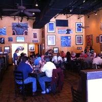 Photo taken at MOJO Bar B Que, A Southern Blues Kitchen by Jeff R. on 2/8/2013