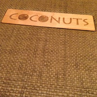 Photo taken at Coconuts Caribbean Restaurant & Bar by Tess C. on 12/18/2012