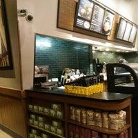 Photo taken at Starbucks by Ali A. on 9/12/2014