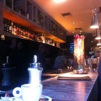 Photo taken at Au Bar by Sandra L. on 12/24/2012