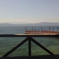 Photo taken at Narlı Beach Club by Onur K. on 7/2/2014