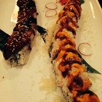 Photo taken at Takara Sushi & Asian Bistro by Teresa C. on 12/21/2013