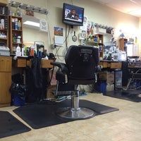 Photo taken at Bigga League Barber Shop by Bill B. on 3/22/2014