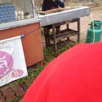 Photo taken at หมูปิ้งอัญชลี อร่อยที่สุดใน 3 โลก by Nnamyenn on 7/22/2016