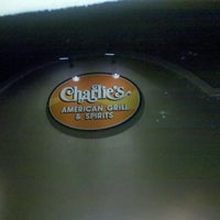 Photo taken at Charlies American Grill & Spirits by Alisha O. on 3/15/2012